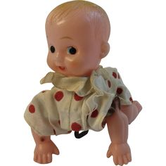 This is a vintage wind up crawling baby from the Mid-Century around 1950's.  The wind up works well and the baby crawls along.  The face on the baby