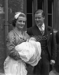Earl Spencer and his wife, Frances holding Diana on her christening day.