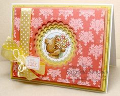 four layers of cardstock each with scalloped circle die cut out in graduated sizes