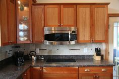 How to remove Grease from Cabinets, without damaging wood surface
