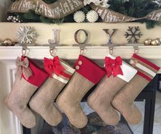 Each stocking is fully lined with cream muslin and measures approximately 17 inches long and approximately 8 inches wide at the opening. The stockings hang from a braided jute loop. Buttons and bows a