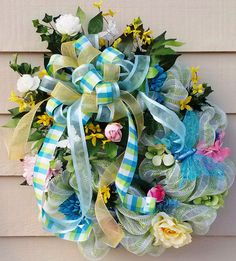 Spring/Summer Deco Mesh Wreath in shades of green, blue, yellow, pink, and white. by wreathsnpretties on Etsy