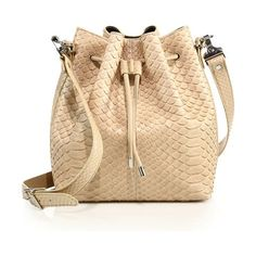 Medium python bucket bag by Proenza Schouler. Cinched silhouette cast in luxe pythonRemovable, adjustable crossbody strapDrawstring closureSilv...