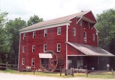(Adams Mill in Cutler, Indiana). John Adams, from Pennsylvania, found this mill site in 1831. He first built a sawmill and then a grist mill in 1835. The present mill was built in 1845-1846. Adams ran 4 sets of millstones powered by two turbines. The two turbines were set in the millrace below the mill. Today, the mill is a historical museum and is on the register of National Historic Places.