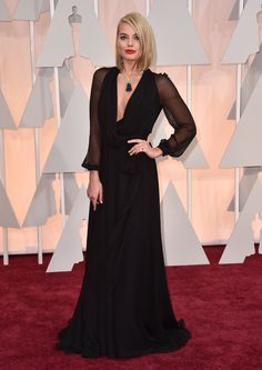 "The 2015 Oscars -Focus"" star Margot Robbie evoked a bygone era on the 2015 Oscars red carpet in a gauzy black Saint Laurent dress that was the epitome of understated elegance. But it was her jaw-dropping statement necklace that sealed the deal and made her one of the best-dressed stars of the night."