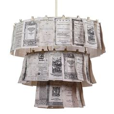 book page chandelier: could DIY with 3 embroidery hoops + clothespins or binder clips (from https://www.jossandmain.com/Tiered-Clip-Chandelier~XRL1065~E660.html?referrerid=amw)