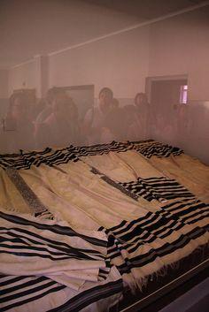 Block 5. Jewish prayer shawls which belonged to people deported to Auschwitz.