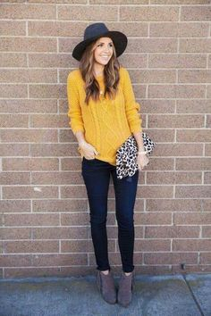 Nadire Atas on Insane Winter Outfits You Will Love fall / winter - fall outfits - street style - street chic style - casual outfits - yellow cable knit sweater + dark denim skinny jeans + brown fringe booties + leopard print clutch + dark grey fedora Mustard Sweater Outfit, Mustard Yellow Outfit, Mustard Yellow Sweater, Sweater Outfits, Sweater Fashion, Yellow Jumper Outfit, Black Hat Outfit, Fedora Outfit, Mustard Top