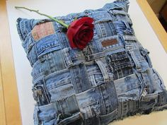 Denim Pillow made from the waistbands of old blue jeans.  So Cute!  Found on Etsy.  BlueJeanRevival