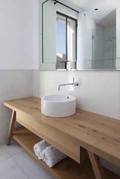 should have probably installed a better sink bowl design, but the wood counter table is awesome.