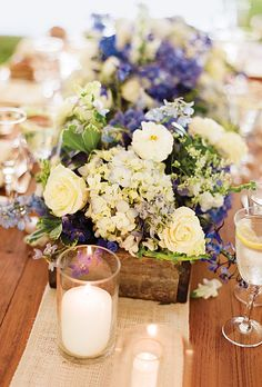 As seen on Brides.com: Centerpieces with hydrangeas, Queen Anne's lace, roses, and delphiniums in wooden boxes. Diana Gould Ltd.