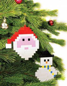 Santa and snowman Lego christmas decorations hang on a tree