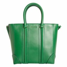 Givenchy Medium Lucrezia Tote: Smooth lambskin leather top zip tote with rolled top handles, reinforced corners at base and a detachable/adjustable shoulder strap. Spiked stud detailing at shoulder strap and base of bag. Cotton canvas lining with zipper pocket and slip pockets.
