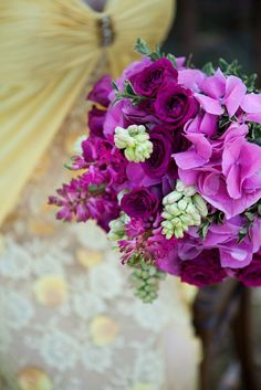 All purple flowers for tables.. i think look stunning. And would look amazing with aqua napkins and while table settings....
