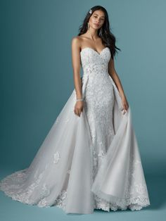 Maggie Sottero - KAYSEN, Who knew a silhouette could make you look so svelte and poised? This sparkling mermaid wedding dress has all the right lines and all the right textures.