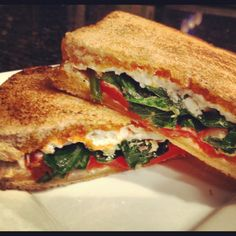 Grilled goat cheese sandwich with sautéed spinach, sundried tomato spread, roasted red pepper and of course goat cheese crumbles.