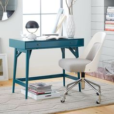 Small space solution. We designed this mini version of our best-selling Mid-Century Desk for those without a lot of extra space. Crafted of FSC®-certified wood and finished on all four sides, you could even float it in a room's center.