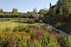 Large swathes of perennial planting helps develop depth and brightness for this stunning contemporary country garden