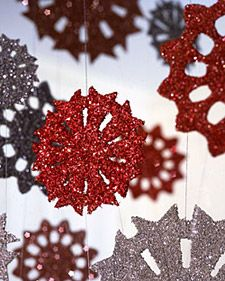 DIY Sparkling Snowflake ornaments  (thinkin' I'd rather do these on cardstock than cardboard - I know the kids won't be patient enough to help with the cutting part!)