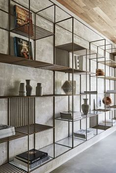 Cement screed wall- metal and glass shelves                              …