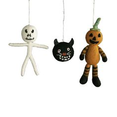 """{This frighteningly cute trio of plush decorations is ripe with vintage allure, thanks to their old school colour pallet and grinning faces that call to mind Halloween decorations from the 1920s or 30s. """"Freaky Felt Ornaments"""", $19.00 (for all three) from Wisteria.}"""