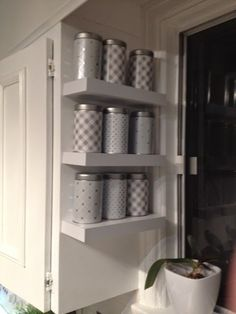 It was time to give my David's Tea tins a fresh face so that I could really show off my tea collection. I made custom tea tin covers and installed a tea wall. Tea Storage, Kitchen Storage, Storage Spaces, Tea Canisters, Tea Tins, Tea Organization, Organizing, Wall Curio Cabinet, Tea Riffic