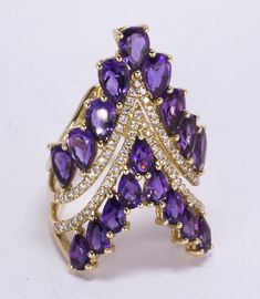 Amethyst, Diamond and 14k Yellow Gold Ring featuring (2) rows of (18) pear-cut Amethysts, weighing a total of approximately 4.40 cts., accented by (2) rows of (75) full-cut Diamonds, weighing a total of approximately 0.38 ct., set in a 14k yellow Gold, chevron-shaped mounting, size 7, gross weight 7.67 grams.
