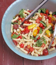 Packed with fresh basil and cherry tomatoes, this Italian pasta recipe comes together in minutes, since the sauce isn't cooked.