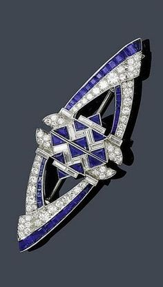 SAPPHIRE AND DIAMOND DOUBLE CLIP, CIRCA 1935. Geometrically designed double clip, set throughout with six triangle-cut sapphires, 21 square-cut sapphires, and eight baguette- and 31 old European brilliant-cut diamonds, mounted in platinum. Mechanical part in white gold. #ArtDeco #clip #brooch