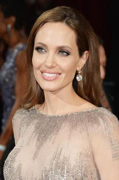 Angelina Jolie Wears Robert Procop She wore 42-carat round diamond drop earrings set in yellow gold.