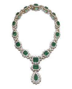 Magnificent emerald and diamond necklace, Bulgari, circa 1970 -  Designed as a graduated series of flower head clusters, each set with a step-cut emerald bordered with brilliant-cut diamonds, spaced by four marquise-shaped diamonds, suspending a pear-shaped and a step-cut emerald surrounded by brilliant-cut stones, length approximately 430mm, Italian assay and maker's marks [Sold for 2,725,519 USD]