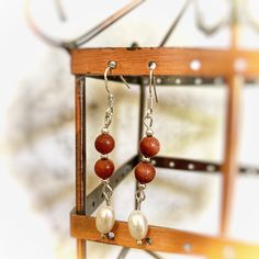 Handmade delicate goldstone & freshwater pearl earrings made with sterling silver hooks Pearl Gemstone, Gemstone Earrings, Pearl Earrings, Handmade Items, Handmade Gifts, Marketing And Advertising, Wind Chimes, Fresh Water, Hooks