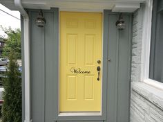 """Obviously we can't do this while we are renting, but one day I think we will have a butter yellow door with the word """"Welcome"""" written on it."""