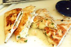 shrimp quesadillas (shrimp, tortillas, cilantro, lime juice, garlic, red pepper, mexican cheese)