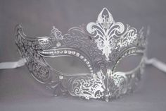 Silver / Grey laser cut metal masquerade mask perfect for wedding masquerade parties, masquerade ball mask for new years party by Stefanelbeadwork on Etsy https://www.etsy.com/listing/211023531/silver-grey-laser-cut-metal-masquerade