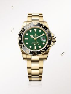 The Rolex GMT-Master II in yellow gold, with a green dial and Oyster bracelet.