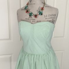 """Lilly Pulitzer Seersucker Strapless Dress adorable and classic Lilly style spring green seersucker pin stripe strapless dress with oh so cute back tie detailing! features back zipper with hook and eye closure and on seam pockets too. excellent condition - worn only once. 100% cotton with 100% cotton lining. bust is 15.5"""" flat, length is 26.5"""". size 8. Lilly Pulitzer Dresses Strapless"""