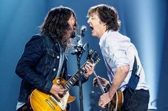 Sir Paul McCartney on stage with Dave Grohl of the Foo Fighters at The O2 Arena, London, on the opening night of the European leg of Sir Paul's Out There tour