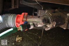 Tips for camping in a travel trailer - clear sewer hose adaptor