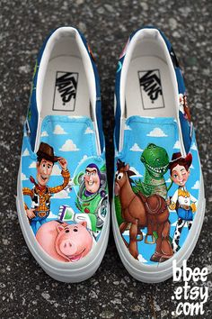 Take your favorite band of talking toys along wherever you go with the Toy Story shoes. These classic slip-on Vans feature a custom graphic of Woody, Buzz, Rex and the rest of the gang drawn in amazing detail. You definitely have a friend in these shoes. Custom Vans Shoes, Custom Painted Shoes, Painted Vans, Painted Canvas Shoes, Hand Painted Shoes, Disney Vans, Disney Shoes, On Shoes, Me Too Shoes