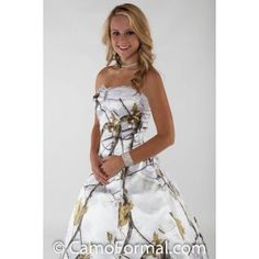 3010 with Lace and Net. Strapless and has a hi-low hemline with cathedral train.  Bodice and skirt edges have lace added. Adult sizes 2-30. Pictured in Realtree AP SNOW and White Tulle . Available in all camo patterns. Made in the USA. *For added fullness, the dress shown is being worn with a drawstring slip.