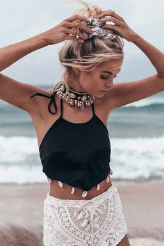 The adorable Shell Trim Halter is a crop style top with a high round neckline, V  hemlineat the waist and ties up at the neck and back. Features amazing shells along the hemline for the perfect beachy look. By Sabo Skirt.