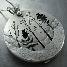 Image of Woodland Forest Locket, Beth Millner, pierced and sawn sterling silver locket with hand sawn trees and hammered details.  This locket has a patina and a brushed satin finish and can hold a small photograph