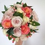 Miss Piggy, Quicksand,cream Avanalche roses, peach hypericum and foliage brides bouquet