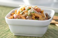 """""""Shipwreck Dinner""""- a one pan meal with ground beef, Kraft mac'n'cheese, frozen peas and canned tomatoes. A quick and easy fave in our house, made a little healthier with very lean beef or turkey (which I season well while browning), whole grain mac'n'cheese, and skim milk. I usually omit the shredded cheese on top, as well. Doesn't add much. Kids gobble it up!"""