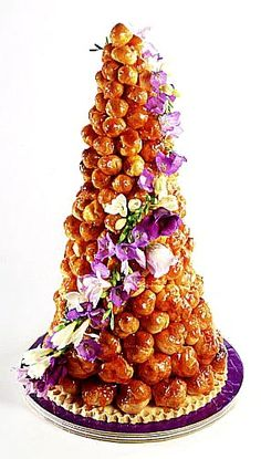 Traditional French Wedding Cake Croquembouche - creampuffs fills, stacked using caramelized sugar, and then strewn with threads of same.