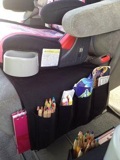 Use an IKEA Remote Control Organizer as a  kid car seat organizer - smart!