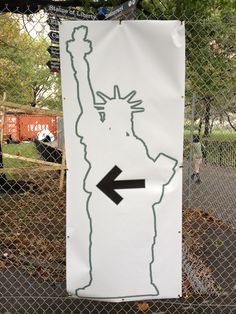 A sign in Battery Park City directing people to the Statue of Liberty that is the same in all languages.