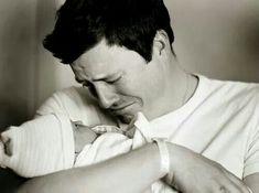 Love at first sight. Newborn + dad photography idea.