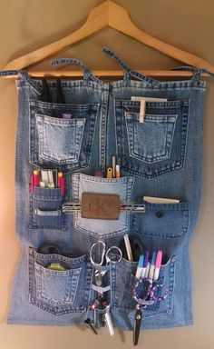 Denim pocket sewing room organizer. I would flip it so the hem was at the bottom and I could use the raw edge to make the channel.